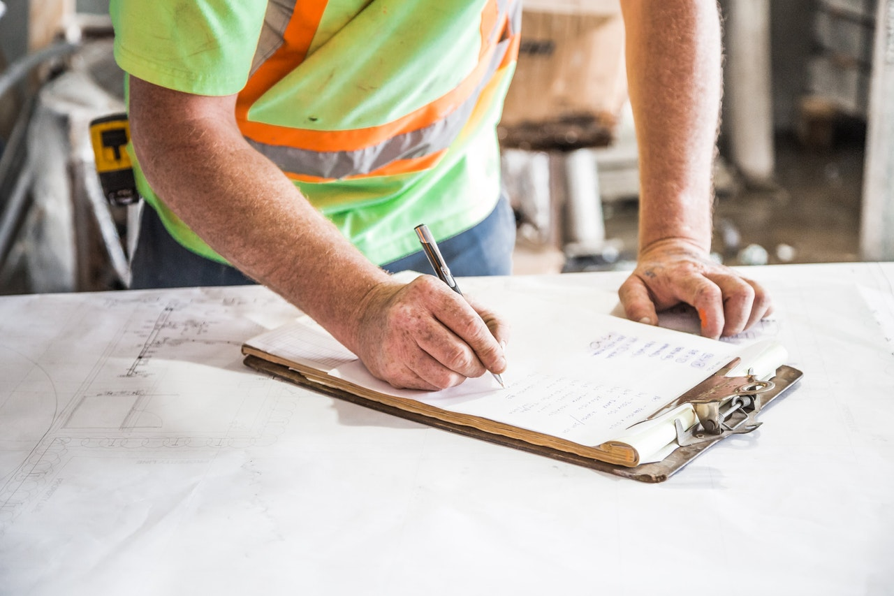 A commercial gas engineer writing down their findings during a gas site survey