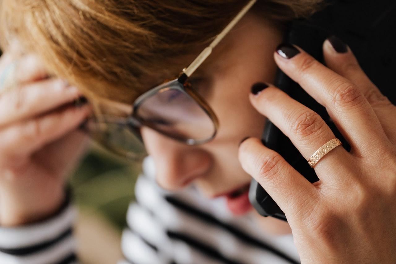Stressed woman on phone seeking help from emergency gas engineers
